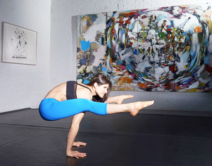 yoga and creativity pose in art gallery