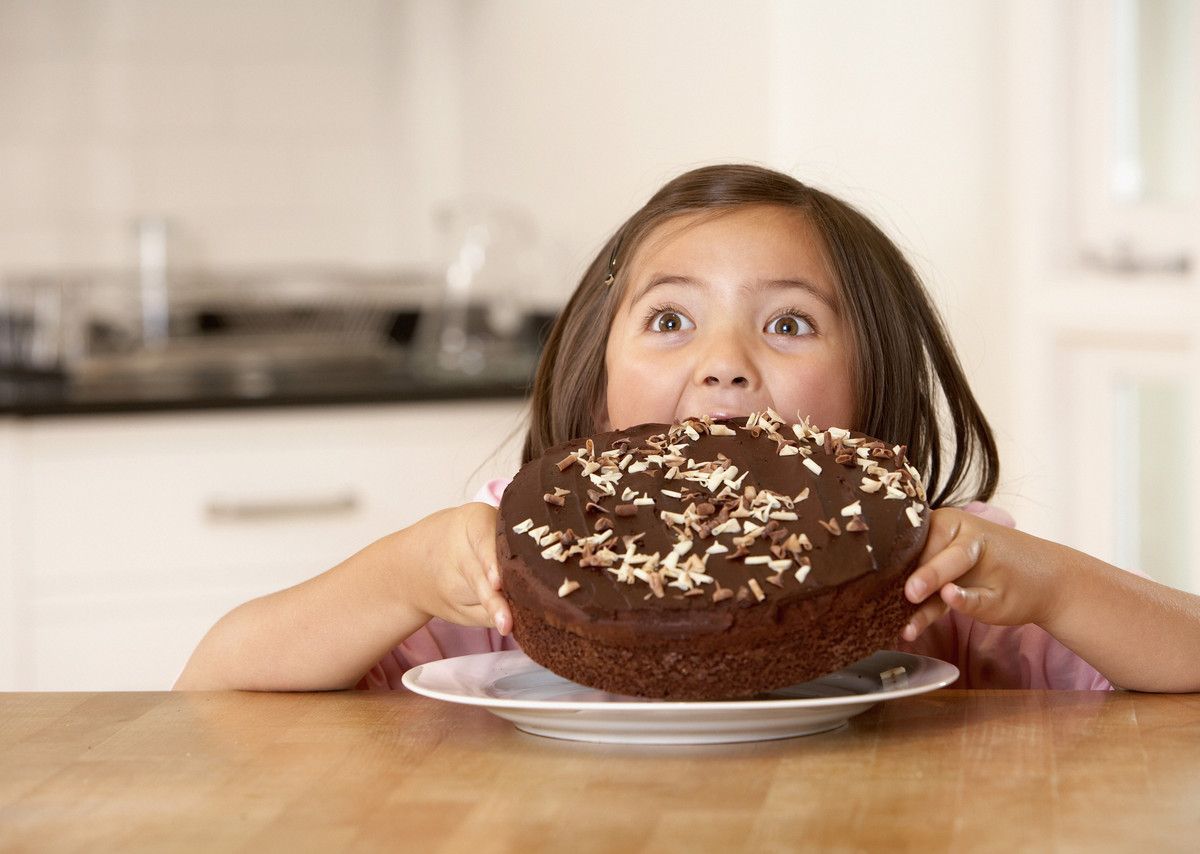 child eating chocolate cake